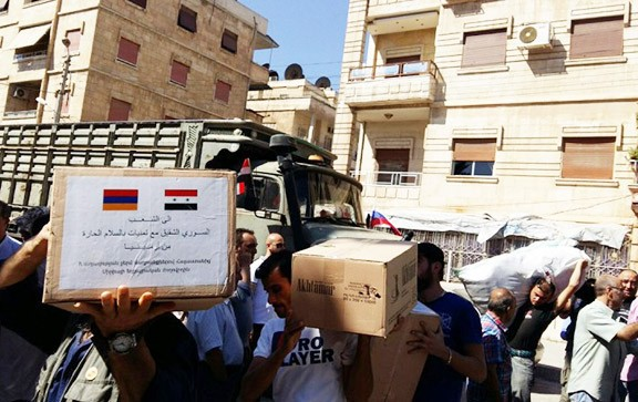 Voluntarios transportan ayuda de Armenia para Siria