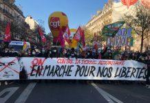 Manifestación en París por la democracia y contra la violencia policial, pancarta de la CGT. 28NOV2020