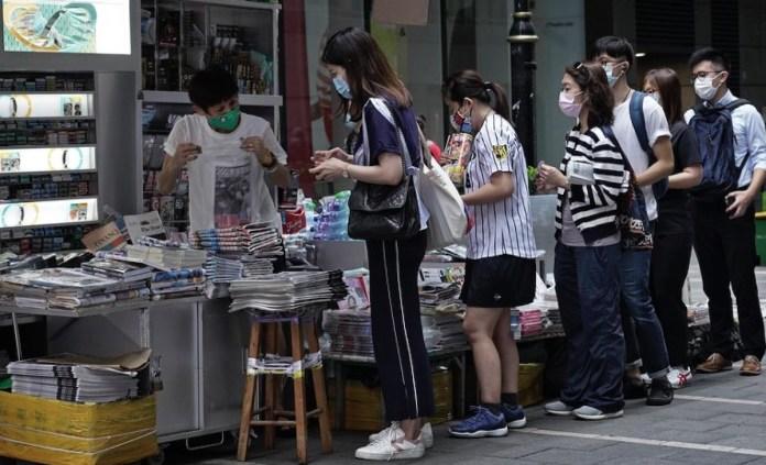 Hong Kong Apple Daily colas quioscos