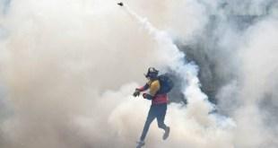 Miembros de bandas armadas fotografiados en Caracas. ANDES/AFP