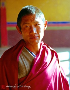 Tibetan monk poses in the Johkang monastery in Lhasa