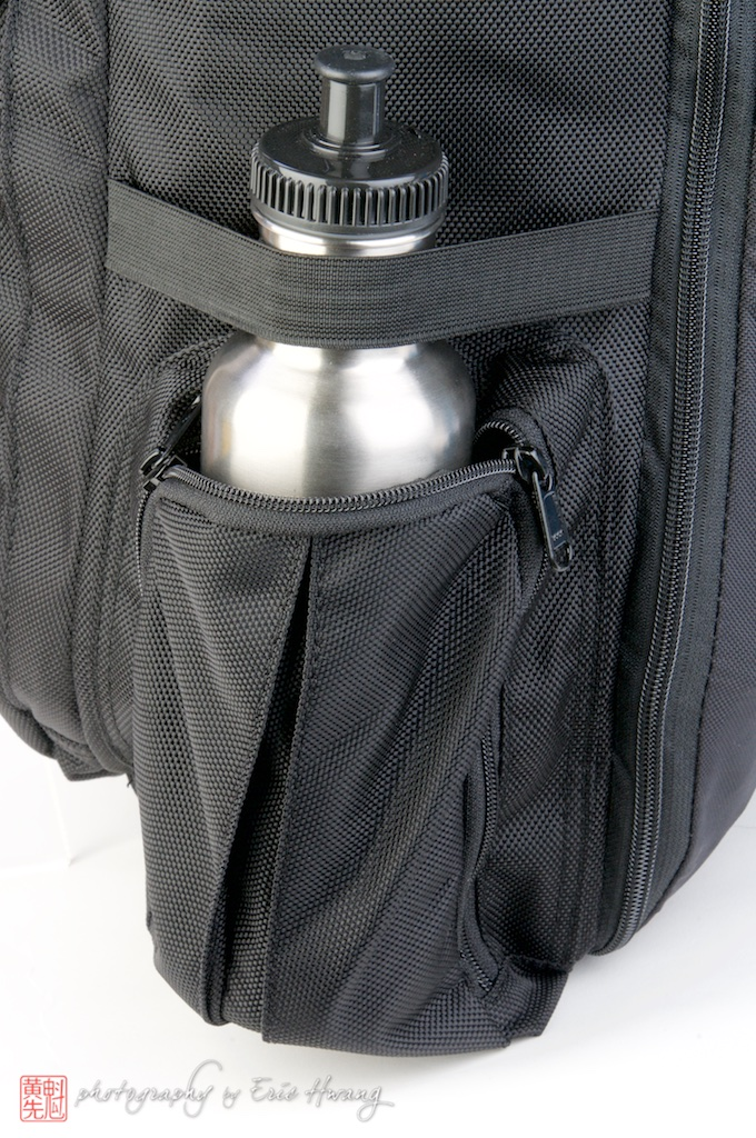 Holds a smaller bottle better with elastic around the neck