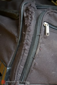 The same fabric on a Travelpro rolling duffel after one roundtrip flight.