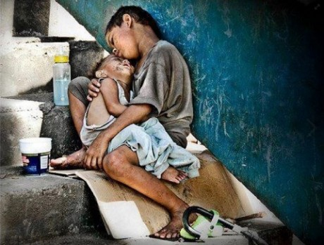poverty-boy-cradling-a-brother-e1386385645657