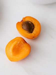 healthy organic apricots placed on table near sliced melon