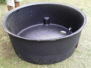Plastic cow trough used as grease trap