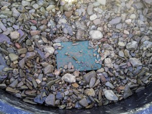 Creek rock in the bottom of the grease trap