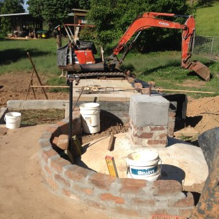 The buried dome of the methane gas bio-digester at the Permaculture Research Institute Sunshine Coast.