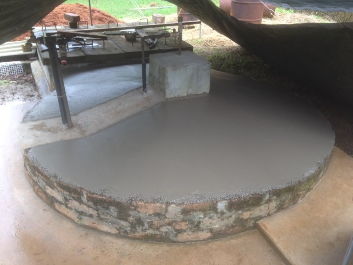 Tom Kendall finishes the concrete dome cover on his Bio-digester at Maungaraeeda.