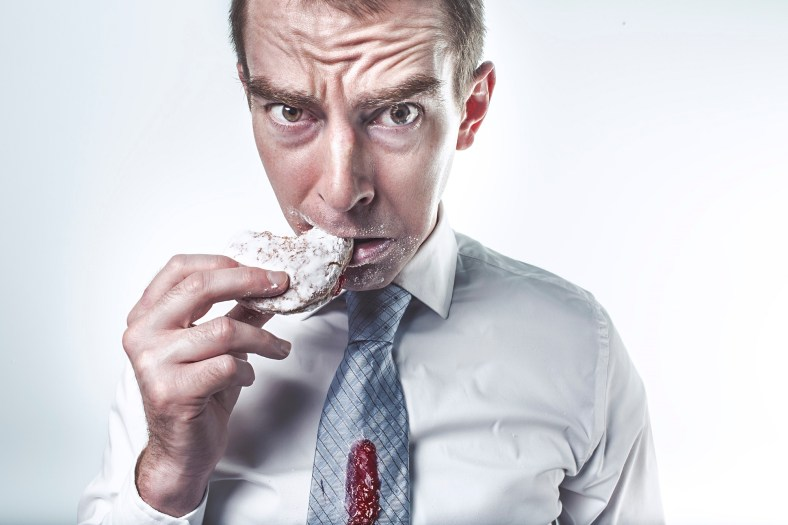 man eating donut