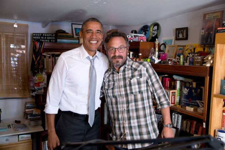 Marc Maron and President Obama pose for a photo.