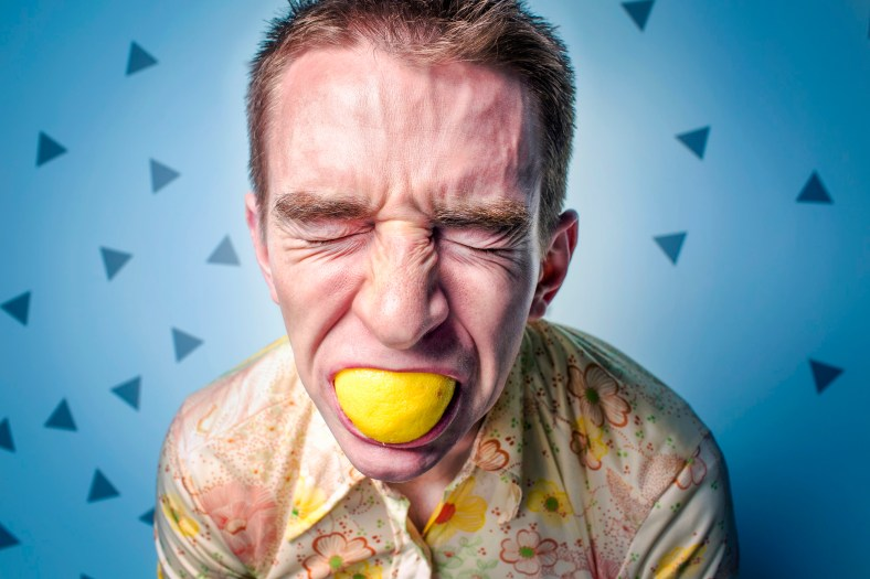 Man eating a lemon