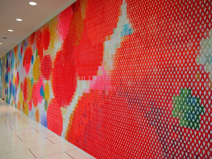 The full wall covered in tiny people