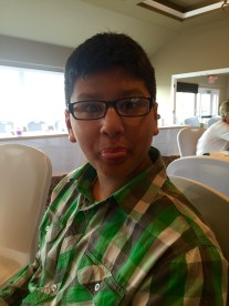 This is my younger brother, Aidan, at the wedding of our mom's friend, making a derp face. He's such a dork.