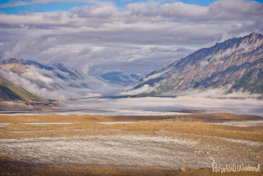 cloud tunnel formation over glacier in alaska
