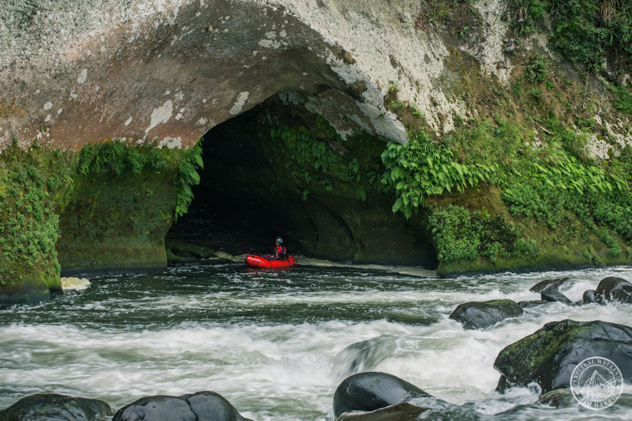 Todd Tumolo explores a cave erroded into the walls along the Rio Antigua
