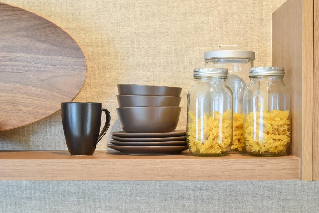 Utah home builder modern ceramic kitchenware and utensils on pantry shelf