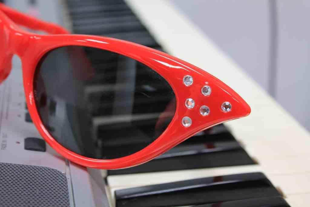 sunglasses on a piano