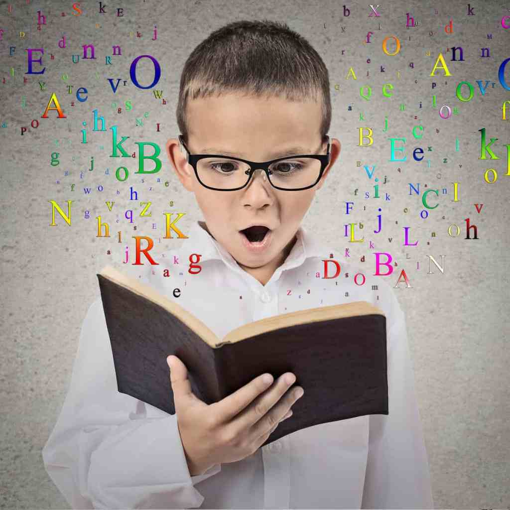 child with glasses reading and learning