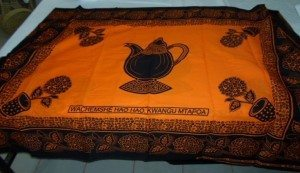 An image of an orange cloth featuring a teapot print.