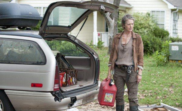 Carol packs the car.