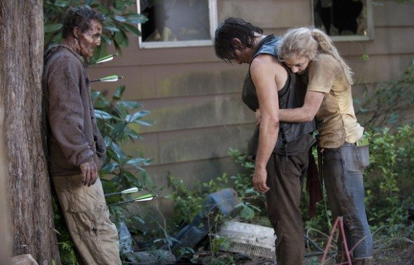 Daryl cries while Beth holds him.