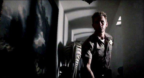 Jason creeps through a foreboding hallway,