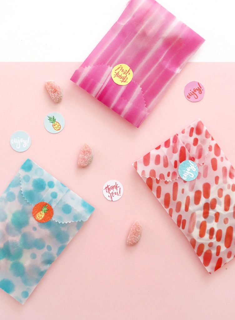 make your own custom goodie bags - these fun watercolor designs are perfect for a summer celebration - free printable papers and stickers - diy printable treat bags