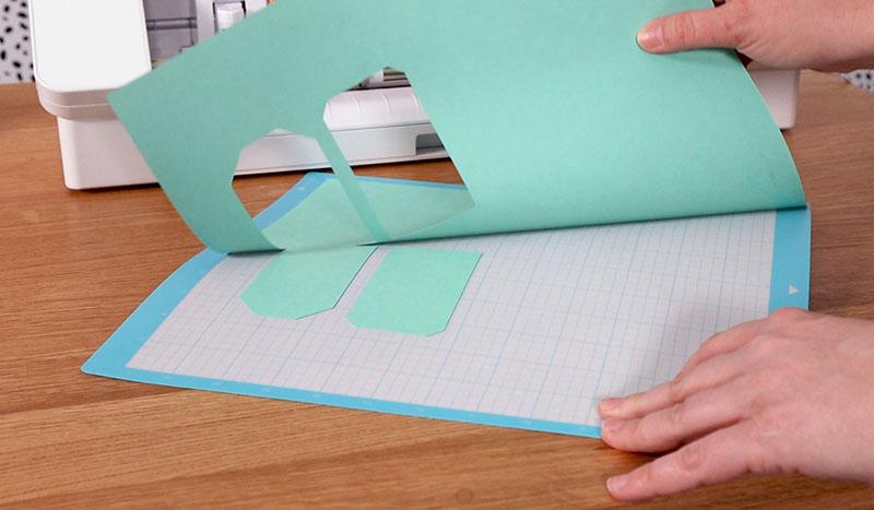 Peeling cut cardstock off of Silhouette cutting mat.