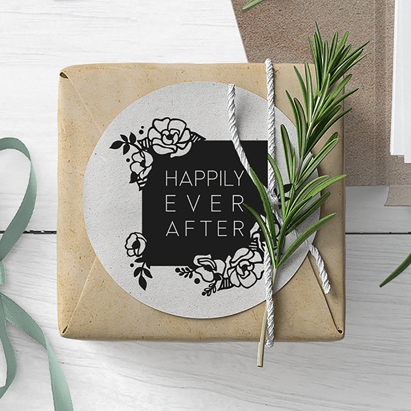 kraft paper wrapped wedding favor with happily ever after sticker on top