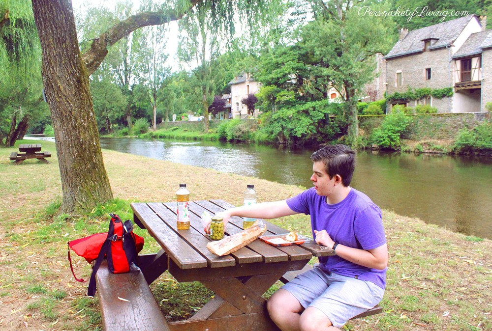 Picnic by the Aveyron River in French town Belcastel