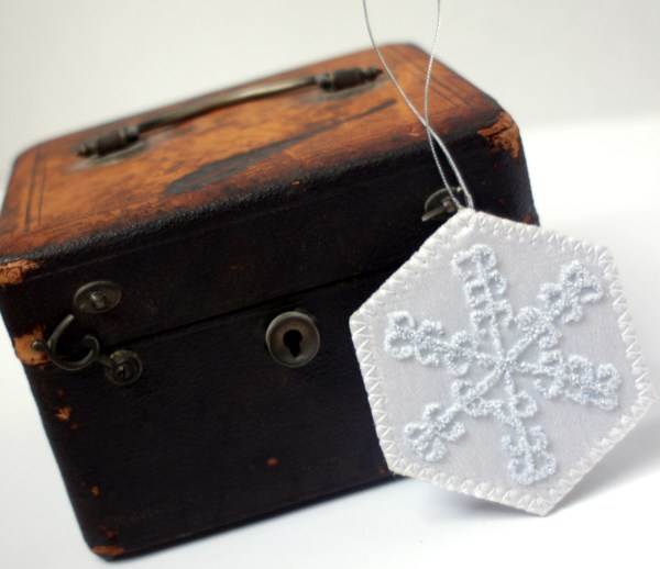 Embroidered white snowflake ornament
