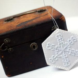 Embroidered white snowflake ornament