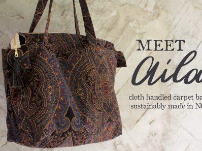 Cloth handle large purse carpet bag