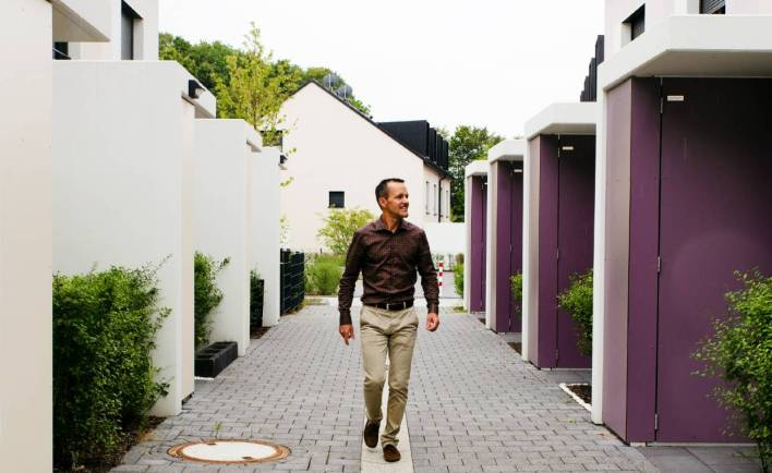 Daniel Arnold, 44, founder of Deutsche terraced house AG, walks through one of his residential parks in Cologne