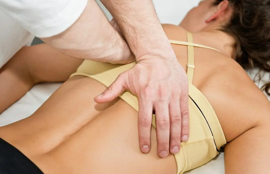 blog picture of lady laying down while chiropractor works on her back