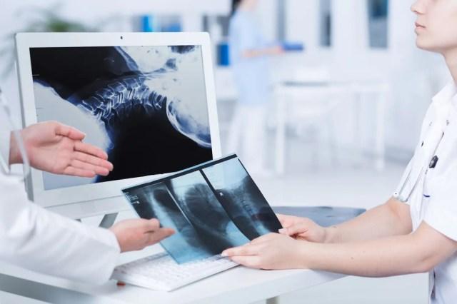 doctors examine x-rays