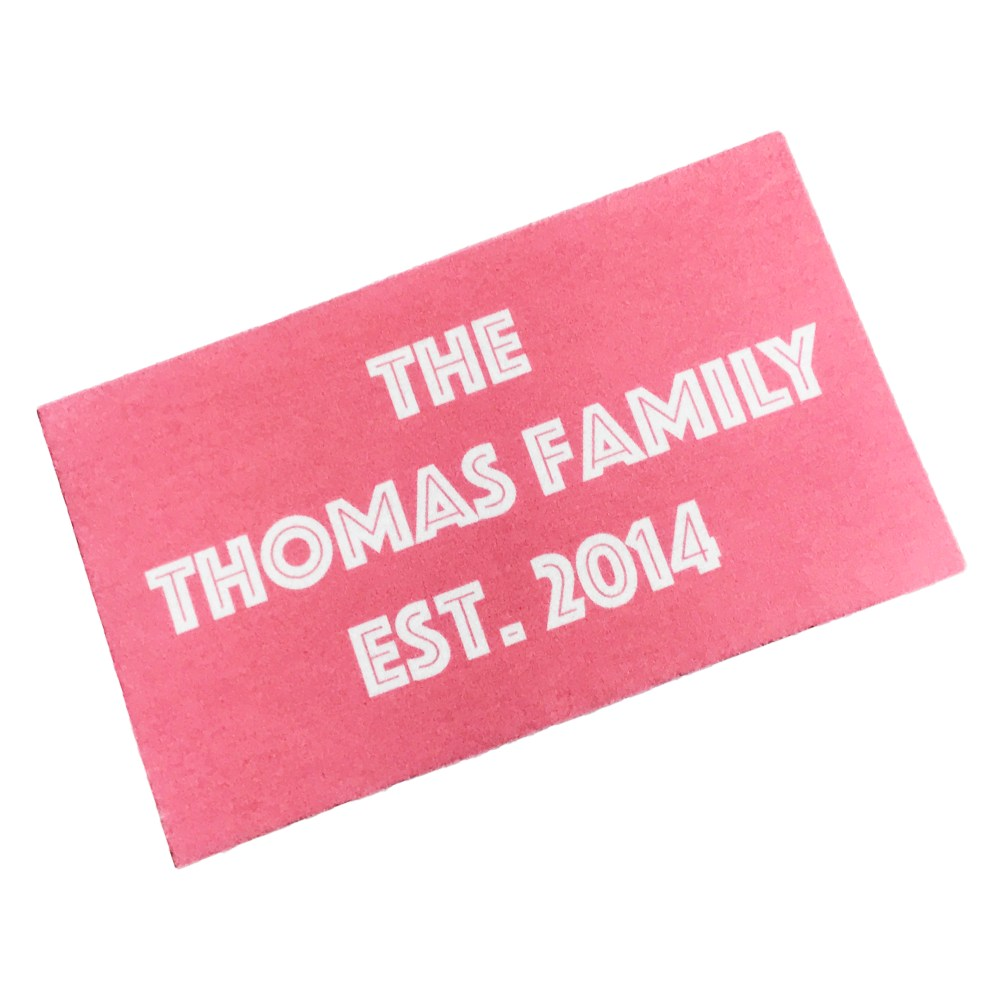personalised doormat with family name and date in salmon pink