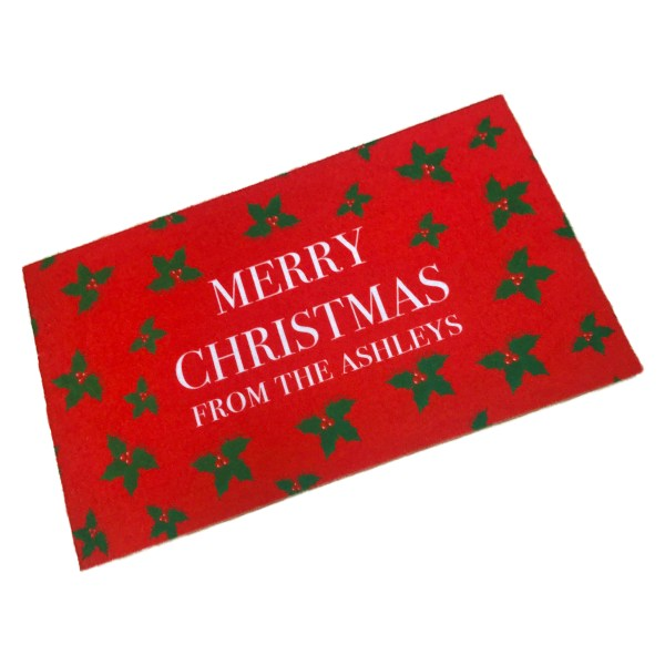 red personalised Christmas washable doormat printed with Merry Christmas and a holly pattern