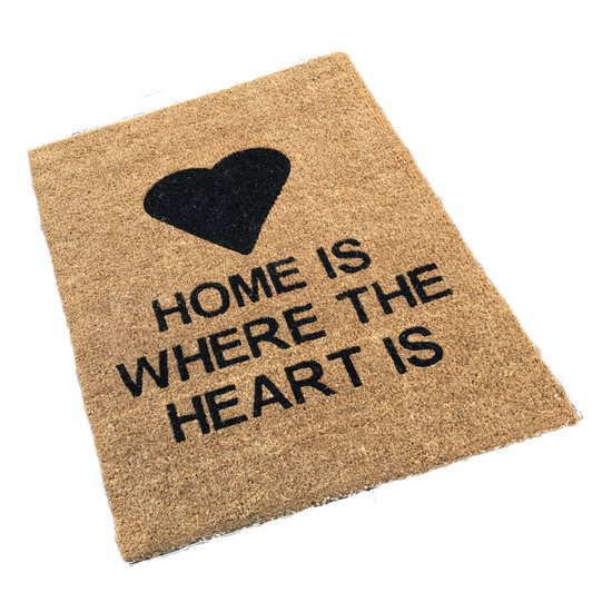 A personalised traditional coir doormat which printed with a heart motif and some text