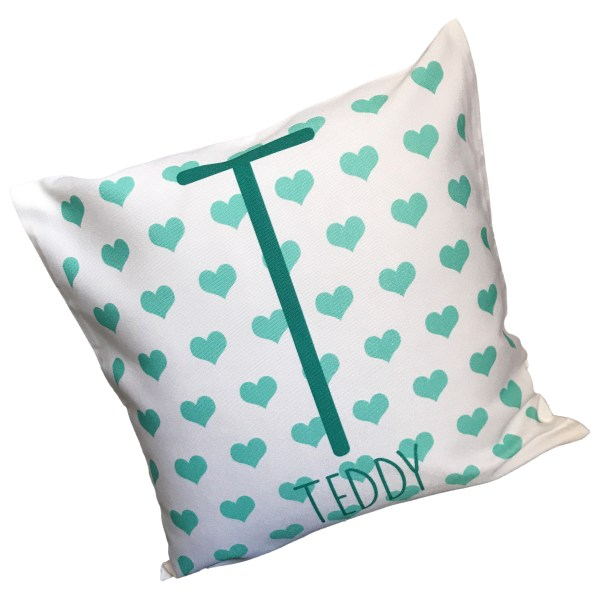 personalised name and initial cushion in cyan with heart background