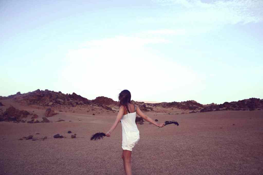 Girl Dancing in the Desert - PersonalProfitability.com
