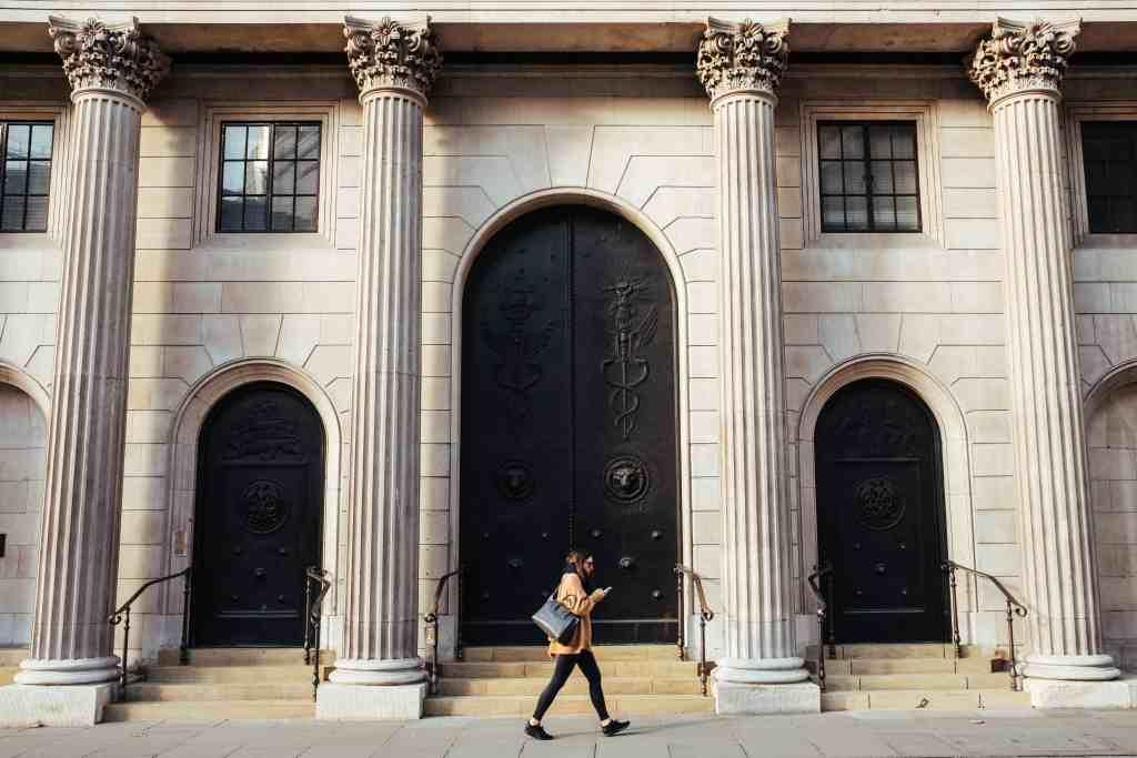 Woman Walking by Bank