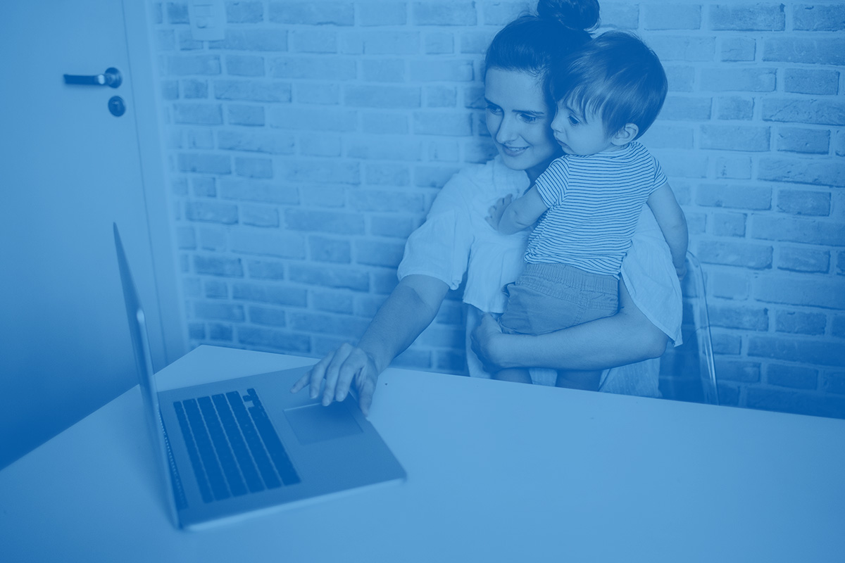 A mother and her son view a computer