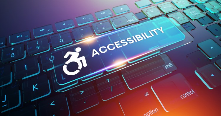 Picture of computer keyboard with icon of wheelchair and word 'accessibility' over it