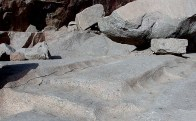 Old cracks in the granite at the Unfinished Obelisk quarry at Aswan. Such cracks were very probably induced by fire in the New Kingdom to ease the extraction of granite. Photo: Per Storemyr