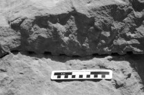 Chisel holes left in a failed attempted to induce a fracture along the base of a block in the Middle Kingdom Wadi Shatt el-Rigal sandstone quarry near Gebel el-Silsila. Note the chisel tracks above the holes, apparently made by the same tool that produced the holes. Smallest scale division is 1 cm. Photo by JAMES HARRELL.