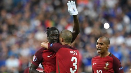Portugal's forward Eder (L) celebrates with Portugal's defender Pepe (C) and Portugal's midfielder Joao Mario after he scored during the Euro 2016 final football match between Portugal and France at the Stade de France in Saint-Denis, north of Paris, on July 10, 2016. / AFP / FRANCISCO LEONG        (Photo credit should read FRANCISCO LEONG/AFP/Getty Images)