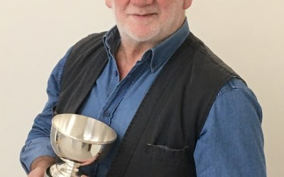 ALLAN G. HENDERSON WITH HIS TROPHY FOR THE STELLA ANNE CORMIE AWARD
