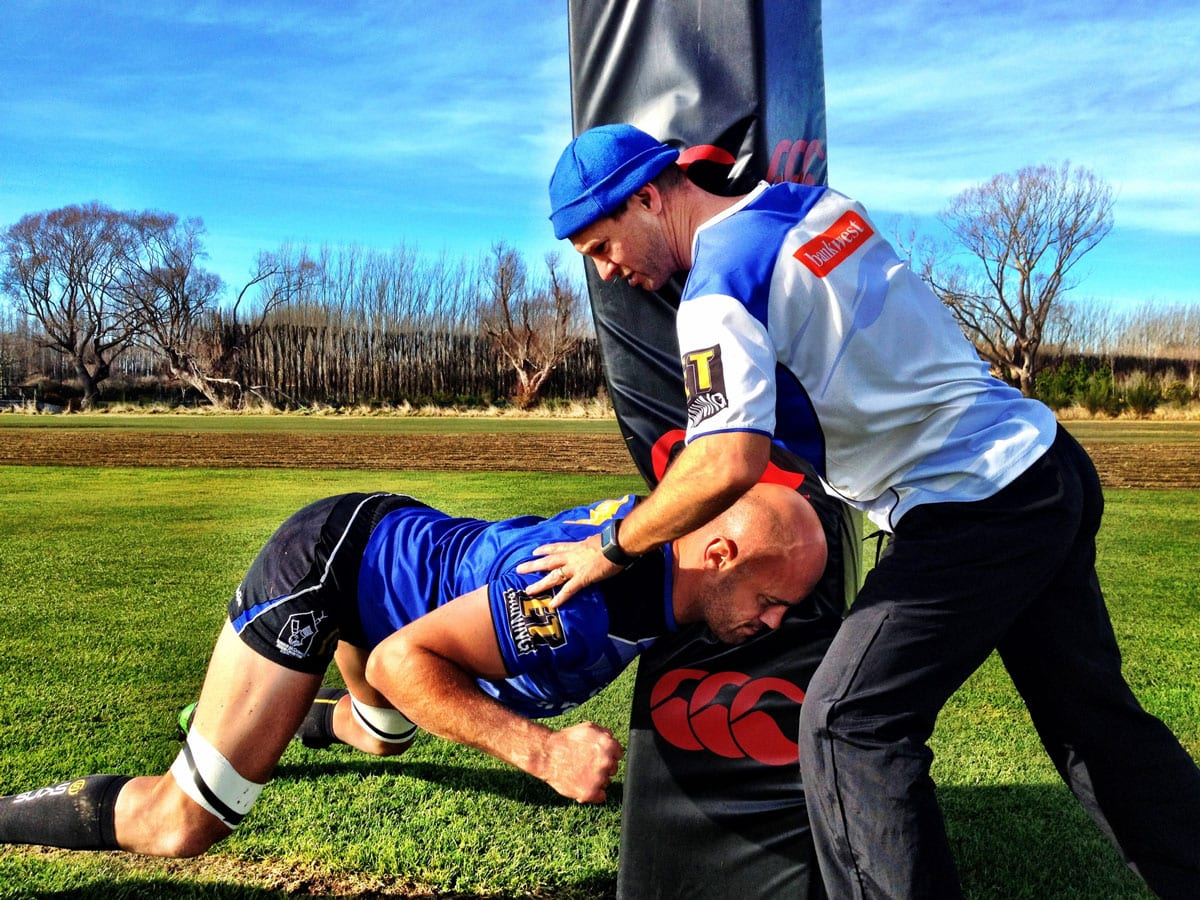 Patient undergoing sports physiotherapy with physiotherapist